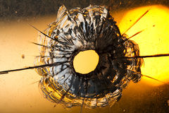 Bullet hole in window. On  sunset Royalty Free Stock Image