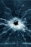 Bullet hole in window royalty free stock photo