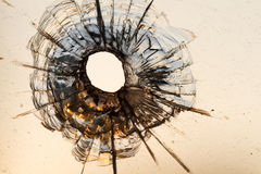 Bullet hole. In a window Royalty Free Stock Images