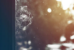 Bullet hole in the window. Bullet hole in the dirty window glass Royalty Free Stock Photography