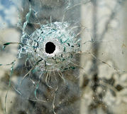 Bullet hole in a window. Bullet hole in a glass window Stock Photos