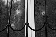 A bullet hole in the window Stock Photos