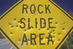 Bullet holes in a �Rock Slide Area� sign, Southern California Royalty Free Stock Photography