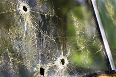 Bullet Holes. An old abandoned truck in a field with bullet holes in the windshield Royalty Free Stock Photos