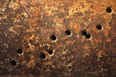 Bullet Holes Background. Rusty metallic surfaces perforated with bullet holes Stock Images