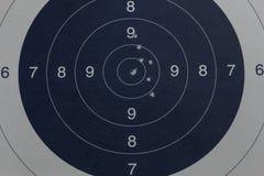Bullet holes in the black target. Little bullet holes in the black target royalty free stock photography