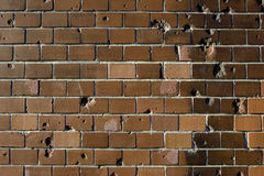 Bullet holes in brick wall Stock Images