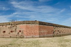 Bullet holes / cannon holes in the brick walls of Fort Pulaski National Monument in Georgia from the Civil War. Blue sky stock images