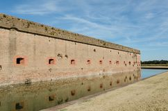 Bullet holes / cannon holes in the brick walls of Fort Pulaski National Monument in Georgia from the Civil War. Sunny day royalty free stock images