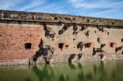 Bullet holes / cannon holes in the brick walls of Fort Pulaski National Monument in Georgia from the Civil War. USA royalty free stock photos
