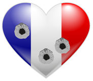 Bullet holes in heart of French flag Royalty Free Stock Photo