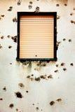 Bullet holes in a house facade Royalty Free Stock Photos