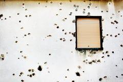 Bullet holes in a house facade. Photo of  Bullet holes in a house facade Stock Photos