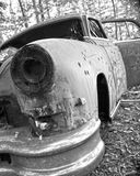 Bullet Holes in a Junk Car. An abandoned car filled with bullet holes Royalty Free Stock Images