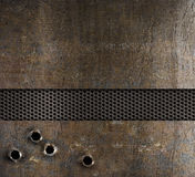 Bullet holes in metal background. Bullet holes in rusty metal background Royalty Free Stock Image