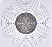 Bullet holes in middle of  practice target. A bullet holes in middle of  practice target Royalty Free Stock Images