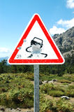 Bullet holes on road sign, Corsica. Road sign  damaged by target practice. Corsica, France Royalty Free Stock Photos