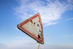 Bullet holes on road sign. Horizontal Stock Photo