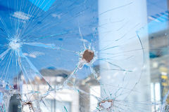 Bullet holes in the window of the shop Royalty Free Stock Photo