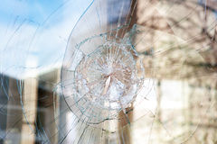 Bullet holes in the window of the shop Stock Image