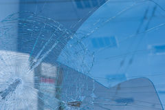 Bullet holes in the window of a shop in city Royalty Free Stock Photos