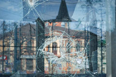 Bullet holes in the window of a shop in Dnepropetrovsk Royalty Free Stock Photography