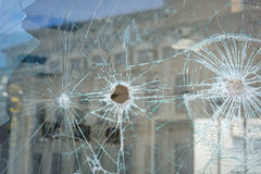 Bullet holes in the window of a shop in Dnepropetrovsk Royalty Free Stock Photo