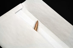 Bullet inside envelope Stock Image