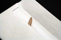 Bullet inside envelope Stock Image