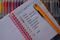 Bullet journal with a pen on colourful background royalty free stock images