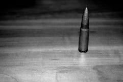 Bullet. Kalashnikov bullet. chuck on the table Royalty Free Stock Image