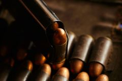 Bullet in magazine scene. The full load of old and dirty spare pistol bullet put in the socket of pocket represent the weapon and bullet concept related idea Stock Photography