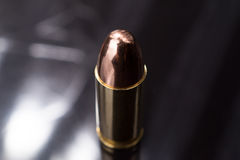 Bullet 9mm. Close up shot of a 9mm Parabellum FMJ bullet Royalty Free Stock Photo