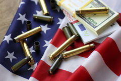 Bullet and money on the american flag Royalty Free Stock Photography