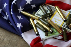 Bullet and money on the american flag Stock Photo