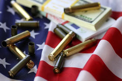 Bullet and money on the american flag Stock Images