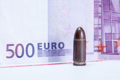 Bullet with money Royalty Free Stock Image