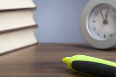 Bullet pen, books,  clock, empty paper Royalty Free Stock Photography