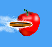 Bullet penetrating an apple Royalty Free Stock Images
