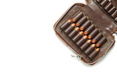 Bullet in pocket scene. The full load of old and dirty spare pistol bullet put in the socket of pocket represent the weapon and bullet concept related idea Stock Image