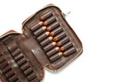 Bullet in pocket scene. The full load of old and dirty spare pistol bullet put in the socket of pocket represent the weapon and bullet concept related idea Royalty Free Stock Image