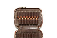 Bullet in pocket scene. The full load of old and dirty spare pistol bullet put in the socket of pocket represent the weapon and bullet concept related idea Royalty Free Stock Photo