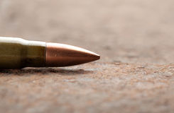 Bullet on rusted metal background Royalty Free Stock Photography