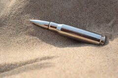 Bullet in the Sand Royalty Free Stock Photos