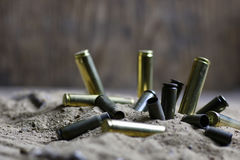 Bullet in the sand. Concept of war in desert Royalty Free Stock Images