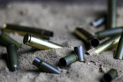 Bullet in the sand Stock Photos