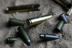 Bullet in the sand Stock Images