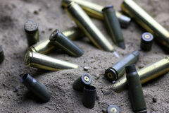 Bullet in the sand Royalty Free Stock Photo
