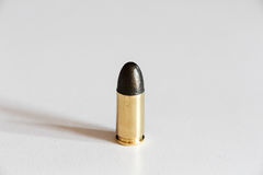 Bullet. Shadow of Bullet one shot Royalty Free Stock Image