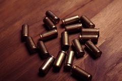 Bullet shells. Empty bullet shells on a wood bacground Royalty Free Stock Image